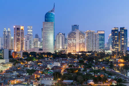 Jakarta downtown skyline with high-rise buildings at sunset Foto de archivo