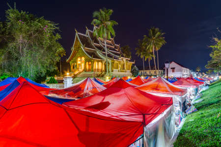 night market: Tents of night market and Royal Palace in Luang Prabang, Laos Editorial