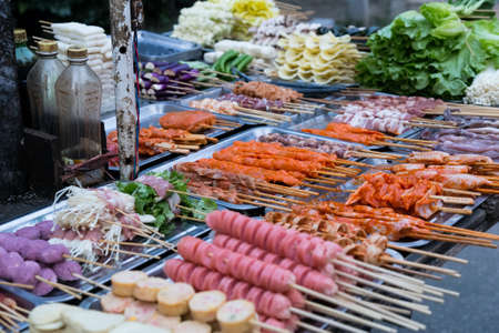 night stick: Oriental Asian barbeque sold at night street market in China