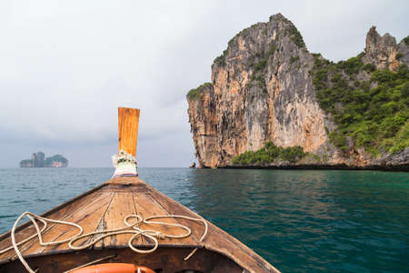 Traditional Thai boat sails to Phi Phi Lee island, Thailand Stock Photo