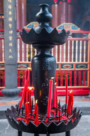 Candles burn in Longshan Buddhist temple in Taipei city, Taiwan