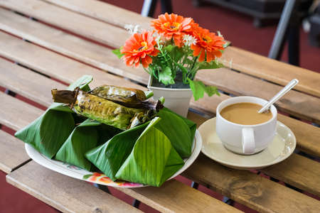 Coffee and palm leaf wrapped sweet Thai dessert