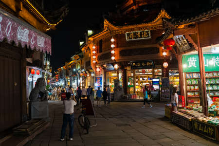 the mainland: Huangshan Tunxi City, China - circa September 2015: Streets and shops of night market of Old Town Huangshan by night