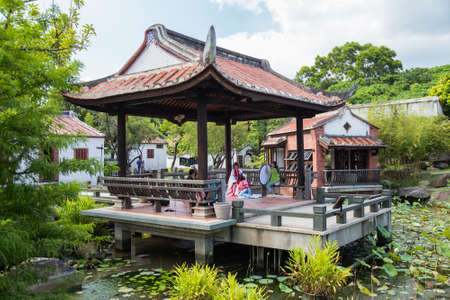 Taipei, Taiwan - circa September 2015: People dressed up in traditional costumes have photographic session in public park in Taipei city, Taiwan Redakční