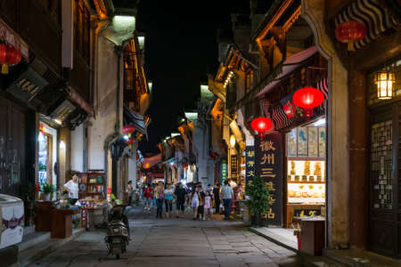 tradition: Huangshan Tunxi City, China - circa September 2015: Streets and shops of Old Town Huangshan by night