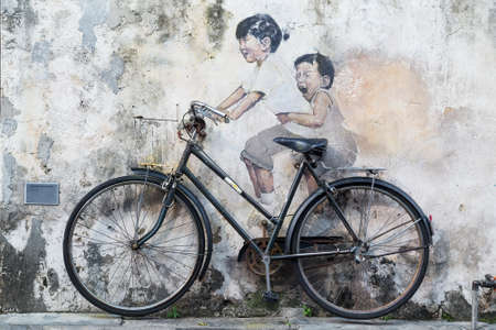 Georgetown, Penang/Malaysia - circa October 2015: Street art and graffiti paintings on the walls of the building in old Georgetown, Penang, Malaysia