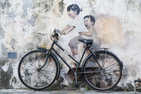 Georgetown, Penang  Maleisië - circa oktober 2015: Street art en graffiti schilderijen aan de muren van het gebouw in oude Georgetown, Penang, Maleisië