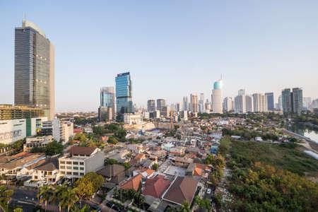 jakarta: Jakarta, Indonesia - circa October 2015: Slums and skyscrapers of Jakarta, city of contrasts