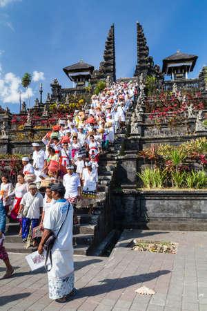 returning: Village of Besakih, BaliIndonesia - circa October 2015: People are returning from praying in Pura Besakih temple Editorial