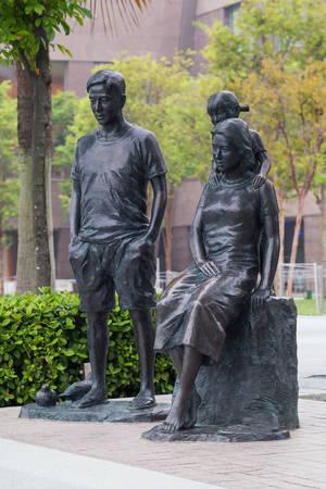 SINGAPORE, SINGAPORE - CIRCA SEPTEMBER 2015: Makan Angin Sculpture of family on Esplanade promenade of Singapore Editorial