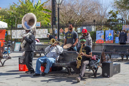 african ancestry: New Orleans, LAUSA - circa February 2016: Young band of musicians perform at Jackson Square, French Quarter, New Orleans, Louisiana Editorial