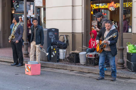 african ancestry: New Orleans, LAUSA - circa February 2016: Band of young musicians perform at French Quarter, New Orleans, Louisiana