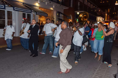 african ancestry: New Orleans, LAUSA - circa March 2009: People playing music and dancing at French Quarter, New Orleans, Louisiana Editorial