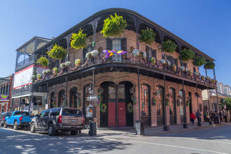 ironwork: New Orleans, LAUSA - circa February 2016: Old Colonial House with ironwork galleries on the Streets of French Quarter decorated for Mardi Gras in New Orleans, Louisiana