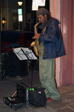 african ancestry: New Orleans, LAUSA - circa March 2009: Musicians perform using saxophone at French Quarter, New Orleans, Louisiana Editorial