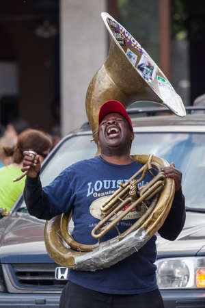 african ancestry: New Orleans, LAUSA - circa March 2009: African-American musician enjoys playing music on tube at Jackson Square, French Quarter, New Orleans, Louisiana Editorial