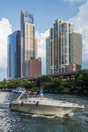 illinois river: Chicago, ILUSA - circa July 2015: High-rise Luxurious Residential Buildings in Downtown Chicago along River Esplanade, Illinois
