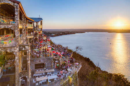 famous industries: Austin, TXUSA - circa February 2016: Sunset above Lake Travis from The Oasis restaurant in Austin, Texas