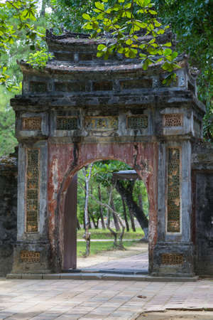 mang: Old gate in Imperial Minh Mang Tomb in Hue