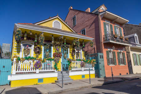 french: Old Colonial Houses on the Streets of French Quarter decorated for Mardi Gras in New Orleans, Louisiana