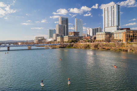 Panorama of Downtown Austin and people kayaking at Colorado river 版權商用圖片