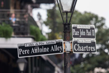 french quarter: Pole with street signs in French Quarter, New Orleans, Louisiana