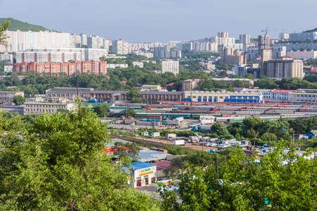 railroads: Vladivostok, Russia - circa July 2015: Panorama of Railroads and residential apartment buildings, Vladivostok, Russia Editorial