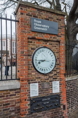 ordenanza: London, UK - circa March 2012: Shepherd 24-hour Gate Clock and Public standards of length in Royal Greenwich Observatory