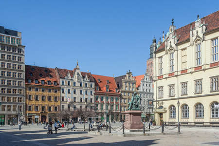 aleksander: Wroclaw, Poland - circa March 2012: Aleksander Fredr monument and central market square in Wroclaw