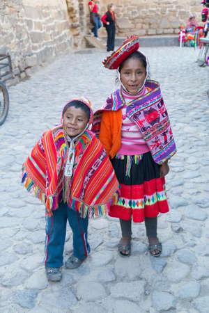 Ollantaytambo, Peru - circa June 2015: Children in traditional Peruvian clothes in Ollantaytambo, Peru