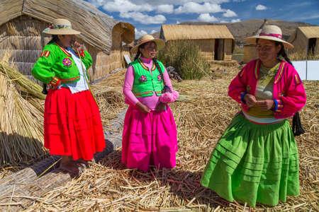 peru: Puno, Peru - circa June 2015: Women singing at Uros floating island and village on Lake Titicaca near Puno, Peru Editorial