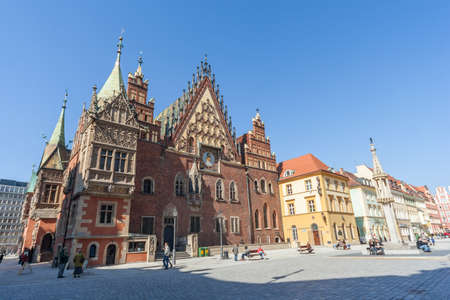 central market: Wroclaw, Poland - circa March 2012: Central market square, pregierz and gothic town hall in Wroclaw, Poland
