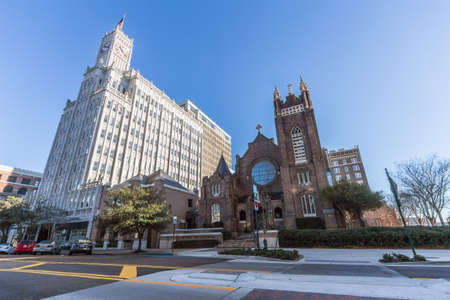 jackson: Jackson, MSUSA - circa February 2016: Lamar Life Building and St Andrews Episcopal Cathedral in Downtown Jackson, Mississippi
