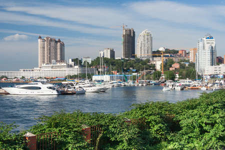 sailing boats: Sailing boats and high rise residential buildings in Vladivostok, Russia