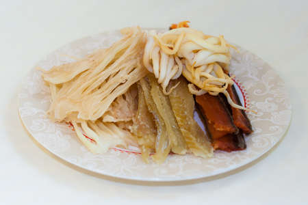far eastern: Dried salted and smoked squid calamari and fish - seafood in Russian Far Eastern Cuisine