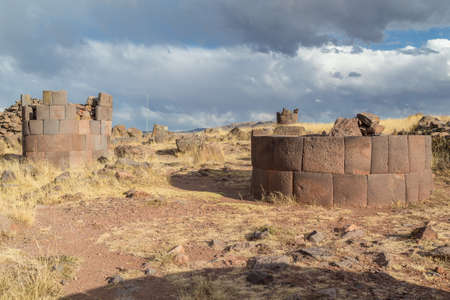 cylindrical: Sillustani Ancient burial ground with giant Chullpas cylindrical funerary towers built by a pre-Incan people near Lake Umayo in Peru