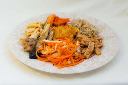 far eastern: Korean salads, soy, kimchi, spicy fish, carrots, calamari, tofu and fish - seafood in Russian Far Eastern Cuisine