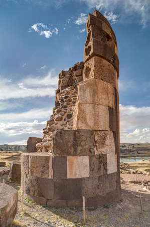 cylindrical: Chullpas giant cylindrical funerary tower built by a pre-Incan at Ancient burial ground with people near Lake Umayo in Peru