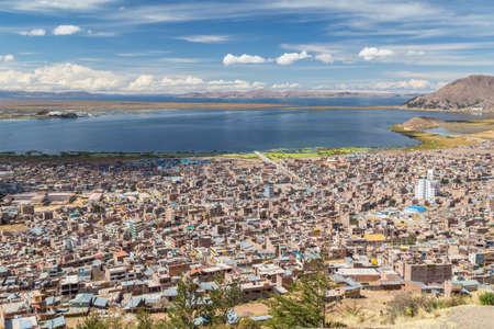 condor: Aerial Panorama of Puno and Lake Titicaca from Mirador El Condor, Peru Stock Photo
