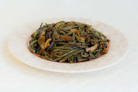 bracken: Salad with salted mushrooms and common bracken, eagle fern (Pteridium aquilinum) - seafood in Russian Far Eastern Cuisine