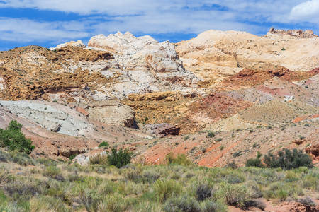 canyonland: Colorful painted rocks with layered sediments in central Utah near Canyonland, Zion, Bryce and Goblin Valley