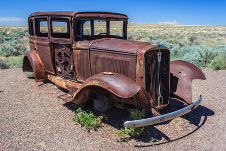 abandoned car: Rusted carcass of old abandoned car at Historic Route 66 in Arizona, USA