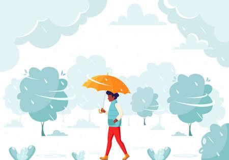 Black man walking under an umbrella during the rain. Fall rain. Autumn outdoor activities.