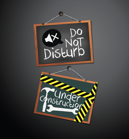 Under construction and do not disturb Signs on blackboard hanging with chain
