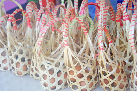 Bamboo baskets with chicken egg on table for sale 스톡 콘텐츠 - 106872957