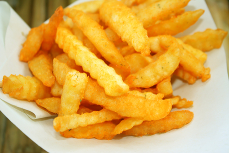 French fries on white papaer