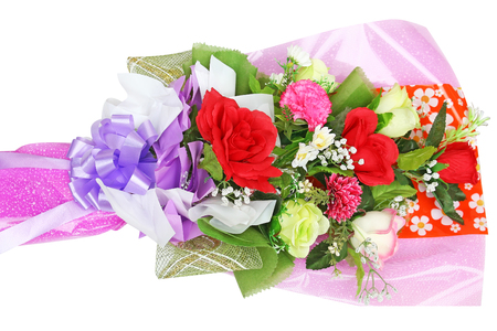 Bouquet  of multicolor artificial flowers isolated on white background Imagens