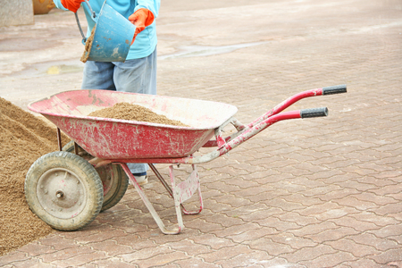 Red wheelbarrow with sand