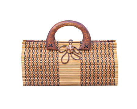 Woven handmade bag made from wood and yarn patterns in horizontal isolated on white background Фото со стока