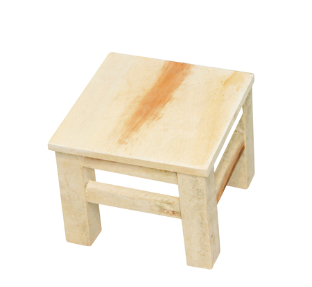Small wooden stool in square patterns isolated on white background with clipping path,handcrafts